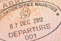 Passport page with Mauritius immigration control departure stamp with traditional Dodo bird depicted on it. Royalty Free Stock Photography