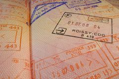 Passport page with Roissy-CDG  French immigration control stamp. Royalty Free Stock Photo