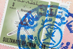 Passport page with the Sultanate of Oman visa and immigration control stamp. royalty free stock photo