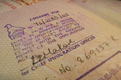 Passport page with Zimbabwe single entry visa stamp. Stock Photos