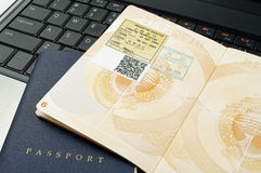 Passport pages and computer. Open passport pages on a computer keyboard Stock Photos