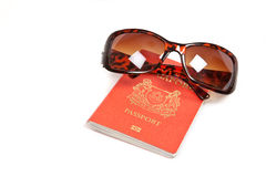 Passport and pair of sunglasses Royalty Free Stock Photography