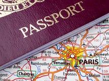 Passport and Paris Map Stock Images