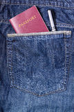 Passport and Pen in Jean Pocket Stock Image
