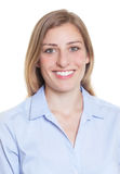 Passport picture of a blonde german woman in blue blouse Royalty Free Stock Photo