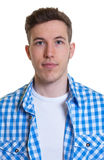 Passport picture of a guy in a checked shirt. On an isolated white background for cut out royalty free stock photo