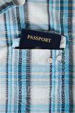 Passport in plaid shirt Royalty Free Stock Images