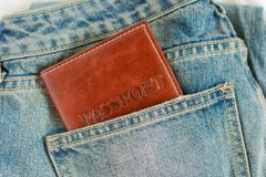 Passport in pocket of blue jeans,preparing for the journey stock photo