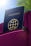Passport in pocket of rouge suitcase Stock Photography