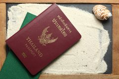 Passport put on slate board scene. Passport put on sand surface represent the tourism and travel industry concept related idea stock photos