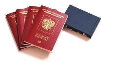 The passport of the Russian Federation. Biometric russian passports are laying around a miniature suitcase on a white background. The concept of travel and royalty free stock image