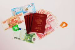 The passport of the Russian Federation. Biometric russian passports, rubles and euro and yuan for the trip. Plastic figures of the ship and the plane stock photos