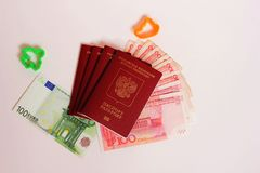The passport of the Russian Federation. Biometric russian passports and euro and yuan for the trip. Plastic figures of the ship and the plane stock image
