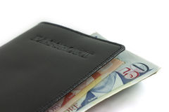 Passport and singapore banknote on white background Royalty Free Stock Photo