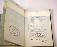 Old British Passport with visa stamps. Passport with spanish and united states visa stamps on the pages ,passport on a isolated white background Royalty Free Stock Photo