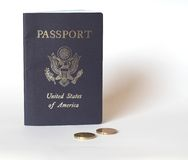 Passport and Spare Change. Passport and some 20 cent Euro coins. Space left on the right for text, etc stock photos