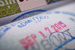 Passport stamp with a caption Admitted in blue ink as a part of Visa page Royalty Free Stock Photography