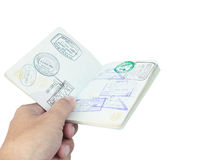 Passport stamp and hand on white stock images