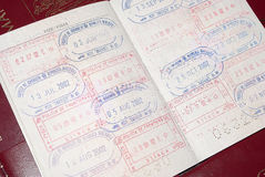 Passport stamps. Open romanian passport with many visas stamps Stock Images