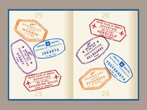 Passport stamps. Colorful visa stamps (not real) on passport pages. International business travel concept. Frequent flyer visas Royalty Free Stock Images