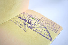 Passport with stamps. Close up on Malaysia Passport with stamps in isolated background Stock Photo