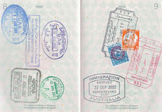 Passport Stamps. Passports stamps from countries such as Australia, Egypt, United Arab Emirates Stock Photo