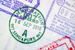 Passport stamps. Close up of immigration stamps in passport page Royalty Free Stock Photography