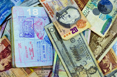 Passport Stamps and Currency Stock Image