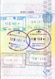 Passport with stamps of Kyrgyzstan, Kazakhstan, Uzbekistan Stock Photos