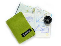 Passport Stamps, travel concept. Immigration arrival stamps on passport and map Royalty Free Stock Photography
