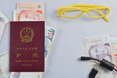 Passport. Still the passport, the new coins, glasses, cables consisting of Royalty Free Stock Images