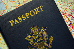 Passport with the symbols of the United States of America. Passport of the United States of America on map, visible distinctive lettering, gold american eagle Stock Photography