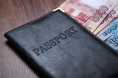 Passport on a table with paper money Royalty Free Stock Photo