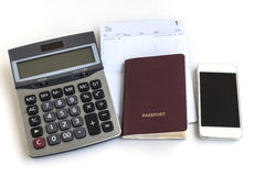 Passport telephone calculator and account passbook on white back Royalty Free Stock Images