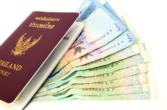 Passport with Thai bank. Notes on white background Royalty Free Stock Photo