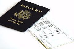 Passport and ticket. Us passport and airline ticket Royalty Free Stock Photo