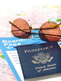 Passport with a ticket and map. Passport on a boarding pass ticket, map and sunglasses Stock Images