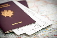Passport and tickets on map royalty free stock photo