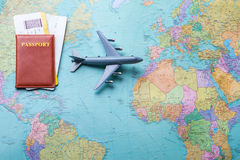 Passport and tickets on map. Stock Images