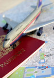 Passport to..... Passport and toy plane on map of Paris Royalty Free Stock Photos
