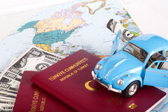 Passport, Toy Car and World Map Stock Photo
