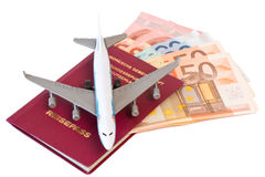 Passport with toy plane and money Royalty Free Stock Image