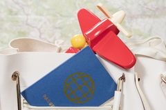 Passport and plane in pocket of bag royalty free stock images