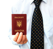 The passport for travel abroad  in a man's hand Stock Photography