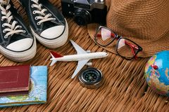 Summer vacation, travel, tourism and objects concept. Passport travel document photo camera sunglasses globe map, top view. Summer vacation, travel, tourism and Stock Image