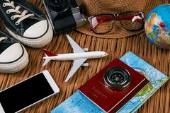 Summer vacation, travel, tourism and objects concept. Passport travel document photo camera sunglasses globe map, top view. Summer vacation, travel, tourism and Stock Photo