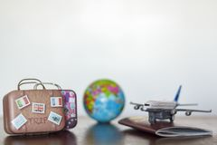 Passport, Travel luggage, earth globe and airplane.  stock photo