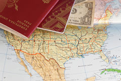 Passport and US dollar bill on a map of the United States Stock Images