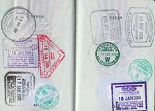 Passport with various stamps. Passport pages with various colorful postmark stamps Stock Image