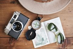 Passport, vintage camera, compass, sunglasses and hat. Royalty Free Stock Photography